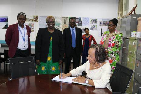 Prof Eudine Barriteau, Pro- Vice Chancellor of the University of West Indies signing the guests register at the Director's office.